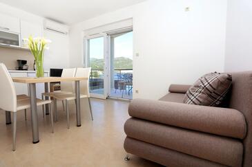 Klek, Obývací pokoj v ubytování typu apartment, dostupna klima i WIFI.