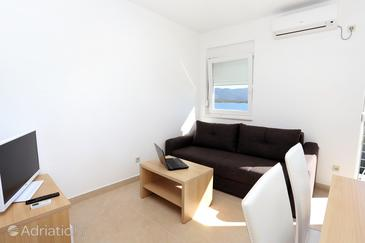 Klek, Living room in the apartment, air condition available and WiFi.