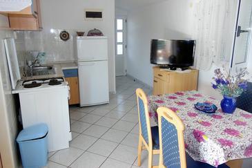 Nečujam, Jedáleň v ubytovacej jednotke apartment, dostupna klima i WIFI.