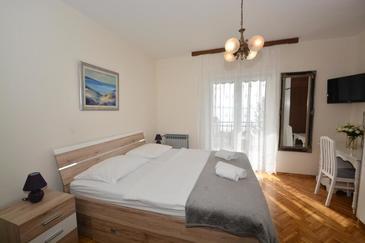 Podstrana, Ložnice v ubytování typu room, s klimatizací a WiFi.