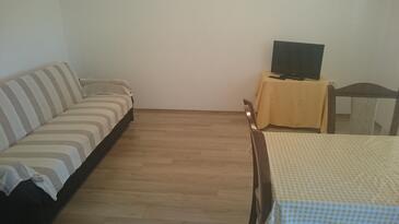 Seline, Obývací pokoj v ubytování typu apartment.