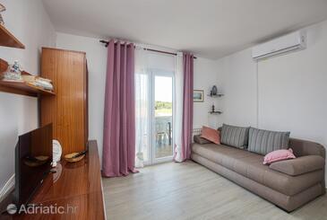 Grebaštica, Obývací pokoj v ubytování typu apartment, s klimatizací a WiFi.