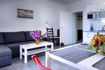 Komiža, Dnevni boravak u smještaju tipa apartment, dostupna klima i WiFi.