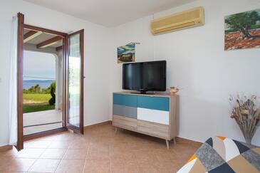Presika, Obývacia izba v ubytovacej jednotke apartment, klimatizácia k dispozícii a WiFi.