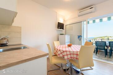 Basina, Eetkamer in the apartment, air condition available en WiFi.