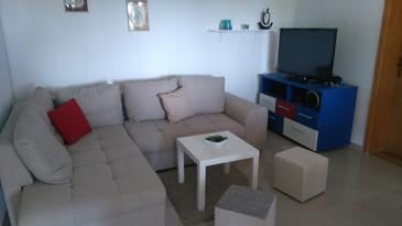 Mokalo, Living room in the house, air condition available and WiFi.