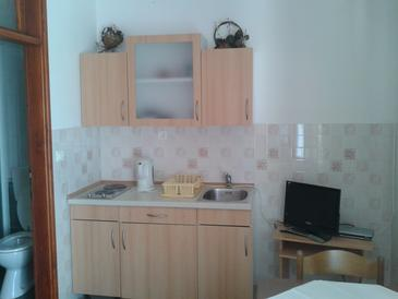 Solaris, Kitchen in the studio-apartment, air condition available, (pet friendly) and WiFi.