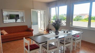 Rab, Столовая в размещении типа apartment, доступный кондиционер, Домашние животные допускаются и WiFi.