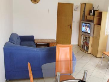 Kabli, Living room in the apartment, air condition available and WiFi.