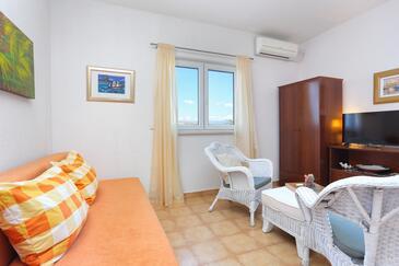 Okrug Donji, Obývacia izba v ubytovacej jednotke studio-apartment, klimatizácia k dispozícii, domáci miláčikovia povolení a WiFi.
