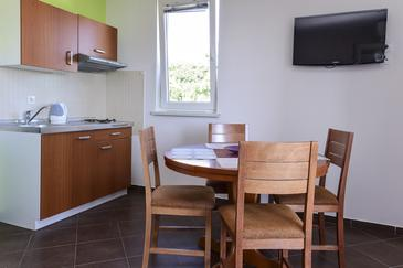 Rtina - Stošići, Comedor in the apartment, air condition available y WiFi.