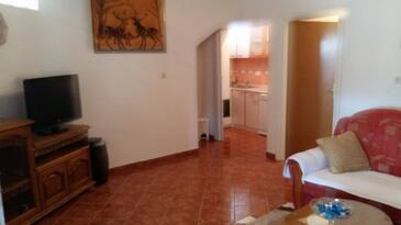 Stivan, Obývacia izba v ubytovacej jednotke apartment.