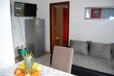 Lumbarda, Obývací pokoj v ubytování typu apartment, s klimatizací, domácí mazlíčci povoleni a WiFi.