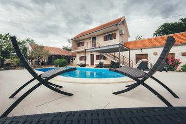 Sonković, Krka, Property 13362 - Vacation Rentals with pebble beach.
