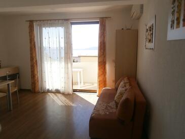 Igrane, Dnevni boravak u smještaju tipa apartment, dostupna klima i WiFi.