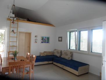 Mokalo, Obývacia izba v ubytovacej jednotke house, klimatizácia k dispozícii a domáci miláčikovia povolení.