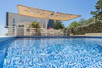 Family friendly apartments with a swimming pool Novalja (Pag) - 14273