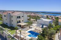 Family friendly apartments with a swimming pool Novalja (Pag) - 14275
