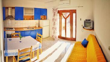Povlja, Jídelna v ubytování typu apartment, s klimatizací, domácí mazlíčci povoleni a WiFi.
