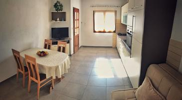 Povlja, Dining room in the apartment, air condition available, (pet friendly) and WiFi.