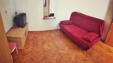 Povlja, Living room in the apartment, (pet friendly) and WiFi.
