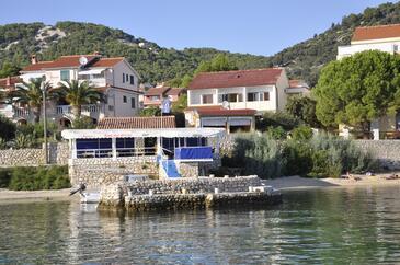 Barbat, Rab, Obiekt 14512 - Apartamenty przy morzu ze żwirową plażą.
