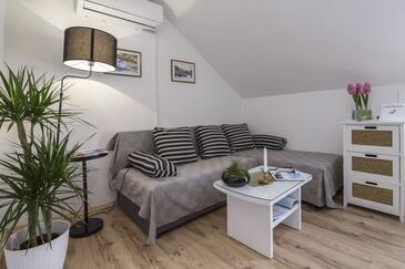 Oključna, Dnevni boravak u smještaju tipa house, dostupna klima, kućni ljubimci dozvoljeni i WiFi.