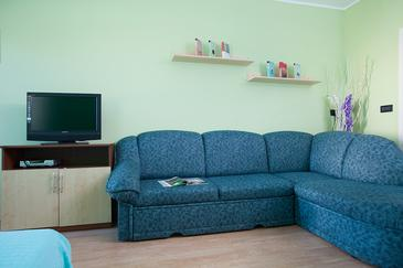 Pula, Living room in the studio-apartment, air condition available and WiFi.