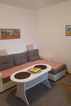 Selce, Dnevni boravak u smještaju tipa apartment, dostupna klima i WiFi.