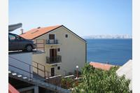 Apartments with a parking space Senj - 15376