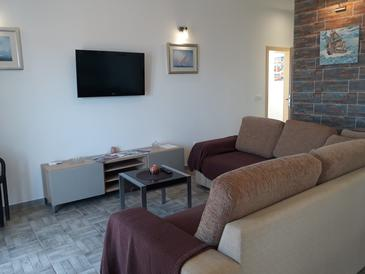 Podstrana, Living room in the apartment, air condition available and WiFi.