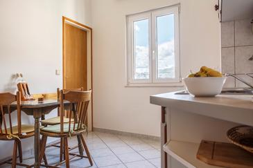 Nemira, Dining room in the apartment, air condition available, (pet friendly) and WiFi.