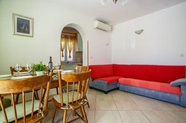 Nemira, Living room in the apartment, air condition available, (pet friendly) and WiFi.