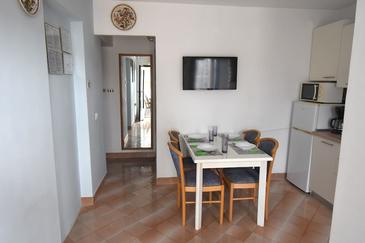 Pula, Dining room in the apartment, air condition available and WiFi.