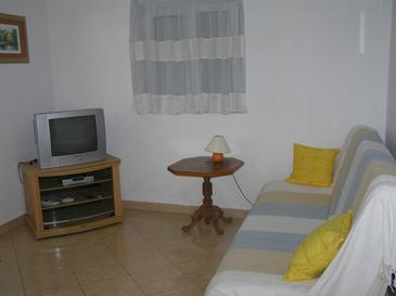 Supetarska Draga - Donja, Living room in the apartment, air condition available and WiFi.