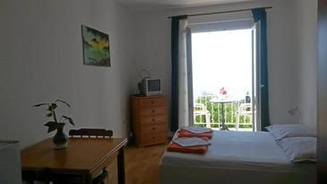 Tučepi, Dormitor în unitate de cazare tip studio-apartment, animale de companie sunt acceptate şi WiFi.
