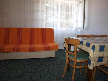 Lopar, Living room in the apartment, air condition available and WiFi.
