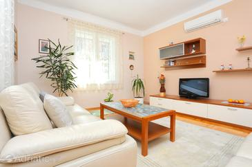 Split, Living room in the apartment, air condition available and WiFi.