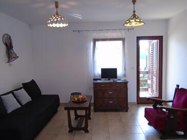 Peroj, Obývací pokoj v ubytování typu house, s klimatizací a WiFi.