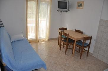 Lopar, Dining room in the apartment, air condition available, (pet friendly) and WiFi.