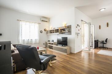 Maslinica, Obývací pokoj v ubytování typu house, s klimatizací, domácí mazlíčci povoleni a WiFi.