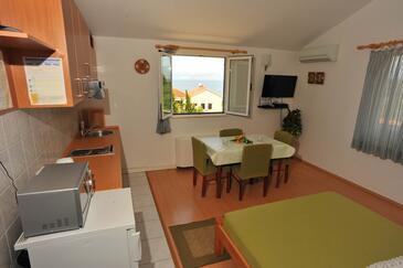 Sutivan, Столовая в размещении типа studio-apartment, доступный кондиционер и WiFi.