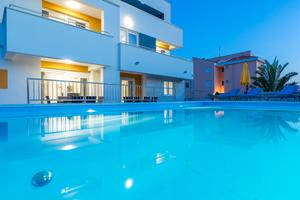 Family friendly apartments with a swimming pool Novalja (Pag) - 17038
