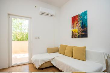 Njivice, Obývací pokoj v ubytování typu apartment, s klimatizací, domácí mazlíčci povoleni a WiFi.