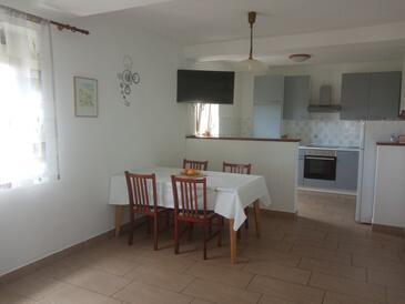 Lopar, Jídelna v ubytování typu apartment, s klimatizací a WiFi.