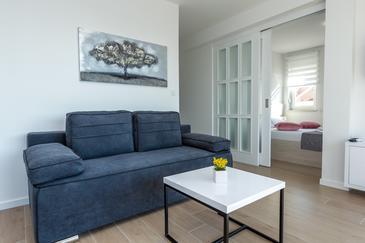 Novalja, Obývacia izba v ubytovacej jednotke apartment, klimatizácia k dispozícii a WiFi.