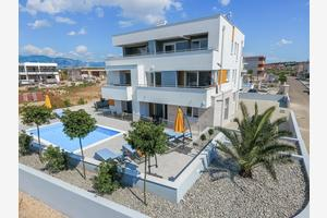 Apartments and rooms with a swimming pool Novalja, Pag - 17217