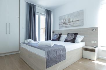Novalja, Spálňa v ubytovacej jednotke room, klimatizácia k dispozícii a WiFi.