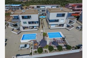 Apartments and rooms with a swimming pool Novalja, Pag - 17225
