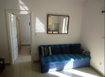 Maslinica, Obývací pokoj v ubytování typu apartment, s klimatizací a WiFi.